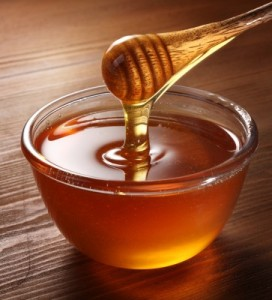 Honey dripping off a spoon