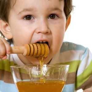 Kid eating honey