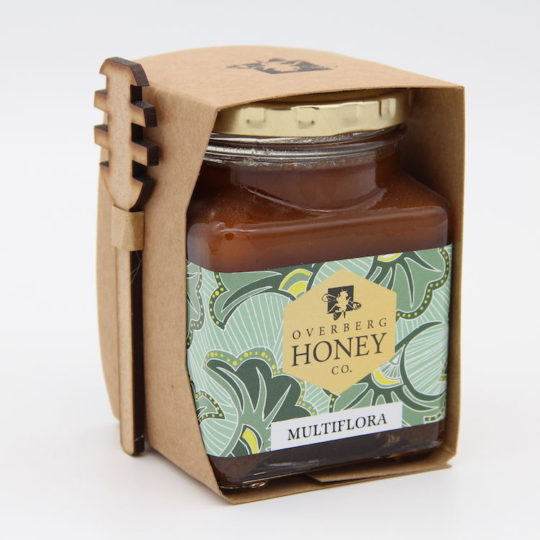 Raw multiflora honey with spoon